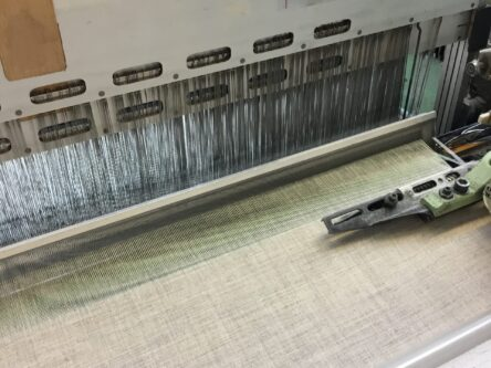 Fabric weaving in textile loom